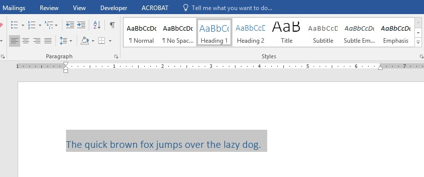Screenshot of Word document with text selected and Heading 1 selected from Styles Gallery.