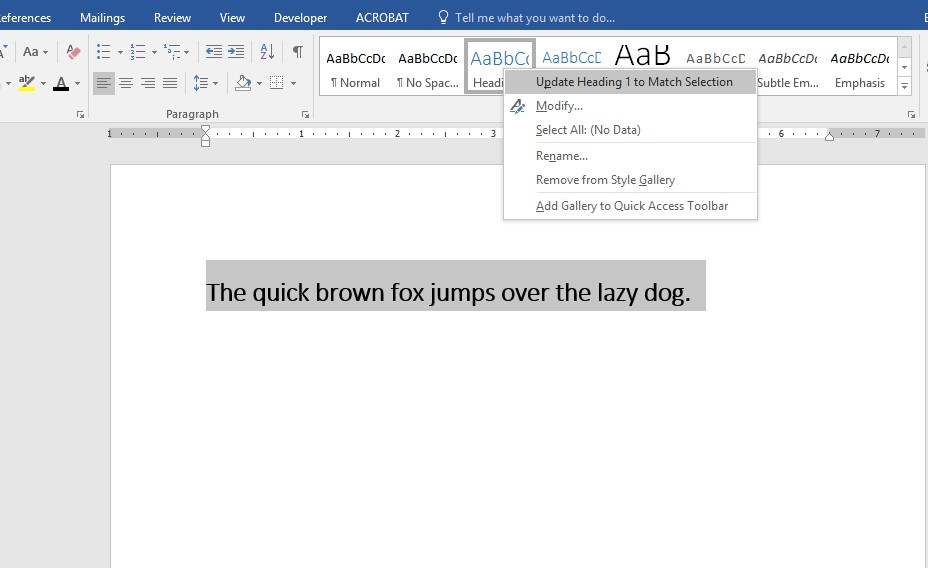 "Screenshot of Word document with text selected. In the Styles Gallery, Heading 1 is selected with a drop down menu. ""Update Heading 1 to Match Selection"" is selected from the menu."